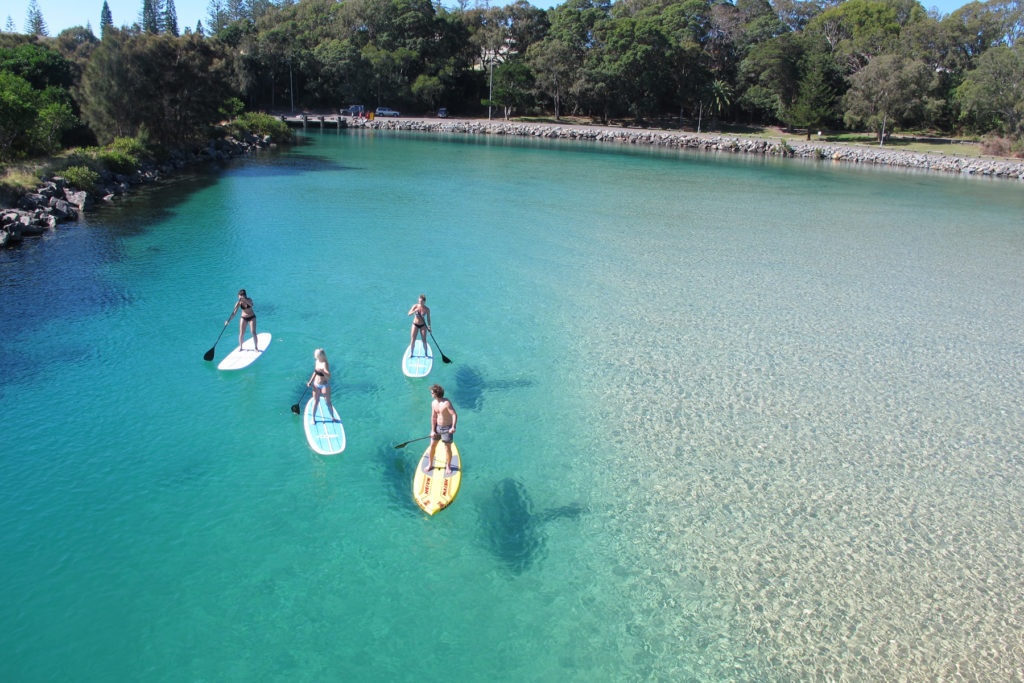 Stand up paddle boarding in beautiful Back Creek, South West Rocks.